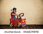 child driving a car made of... | Shutterstock . vector #446829898
