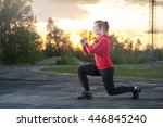 fit woman in sportswear doing... | Shutterstock . vector #446845240