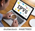 Small photo of IPV6 Internet Protocol larger address space Businessman at work. Close-up top view of man working on laptop while sitting at the wooden desk , coffee