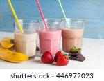 glasses of milkshakes with... | Shutterstock . vector #446972023
