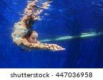 beautiful young woman dive... | Shutterstock . vector #447036958