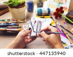 young female hands drawing on... | Shutterstock . vector #447135940