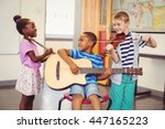Smiling Kids Playing Guitar ...