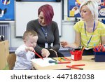 nursery teacher sitting with a... | Shutterstock . vector #447182038