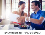 happy couple using a digital... | Shutterstock . vector #447191980