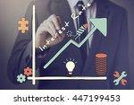 businessman drawing increasing... | Shutterstock . vector #447199453