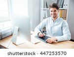 portrait of smiling young man... | Shutterstock . vector #447253570