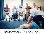 nurse teaching first aid to a... | Shutterstock . vector #447282223