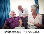 seniors interacting with nurse... | Shutterstock . vector #447289366