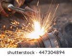 a worker cutting steel using... | Shutterstock . vector #447304894