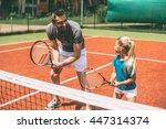 Practicing Tennis. Cheerful...