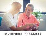female nurse and senior woman... | Shutterstock . vector #447323668