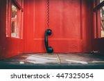 Black Handset Hanging In A Red...