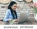 young african woman at cafe... | Shutterstock . vector #447354244