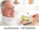 portrait of a man eating a... | Shutterstock . vector #447360328