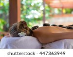 young woman getting hot stone... | Shutterstock . vector #447363949
