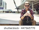man sitting listening music... | Shutterstock . vector #447365770