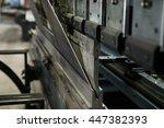 operator bending metal sheet by ... | Shutterstock . vector #447382393