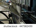 operator bending metal sheet by ... | Shutterstock . vector #447382450