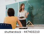 teacher or docent or educator... | Shutterstock . vector #447403210
