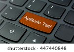 Small photo of Business Concept: Close-up the Aptitude Test button on the keyboard and have Orange color button isolate black keyboard