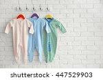set of baby romper on brick wall | Shutterstock . vector #447529903