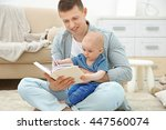man reading book and holding... | Shutterstock . vector #447560074