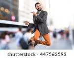 man pointing to the lateral on... | Shutterstock . vector #447563593