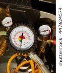 Small photo of Air pressure gauge in a car workshop