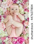 little baby lying in flowers | Shutterstock . vector #447637804