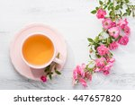 cup of tea and branch of small... | Shutterstock . vector #447657820