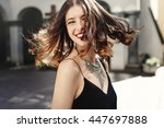happy stylish woman waving hair ... | Shutterstock . vector #447697888