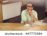 thoughtful hipster using a... | Shutterstock . vector #447773584