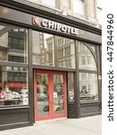 Small photo of New York, New York, USA - July 3, 2016: A Chipotle Mexican Grill restaurant on 6th Ave. in Chelsea, Manhattan. People can be seen in windows.