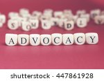 Small photo of Advocacy word written on wood cube with red background