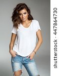 Female Model Isolated On Grey...