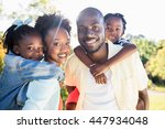 happy family posing together at ... | Shutterstock . vector #447934048