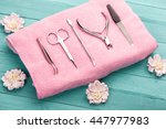 tool for manicure on pink towel....   Shutterstock . vector #447977983