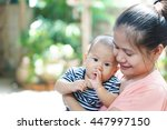 asian mother and son on her... | Shutterstock . vector #447997150