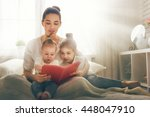 happy loving family. pretty... | Shutterstock . vector #448047910