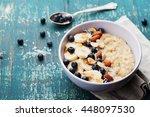 bowl of fresh oatmeal porridge... | Shutterstock . vector #448097530