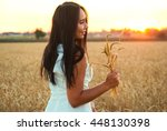 pretty girl in the yellow wheat ... | Shutterstock . vector #448130398