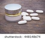 white pills and cosmetic lotion ... | Shutterstock . vector #448148674