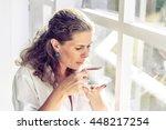 beautiful woman sitting near...   Shutterstock . vector #448217254