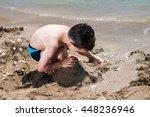 little boy in blue sea playing... | Shutterstock . vector #448236946