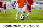 Young Boys Playing Football...