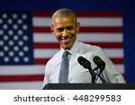 Small photo of CHARLOTTE, NC, USA - JULY 5, 2016: President Barack Obama laughs as he delivers a speech at a rally for the presumptive democratic nominee at the Charlotte Convention Center.