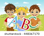 little kids holding the abc... | Shutterstock .eps vector #448367170