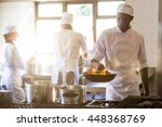 chef tossing stir fry over... | Shutterstock . vector #448368769