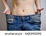 slim waist of young woman thin... | Shutterstock . vector #448390090
